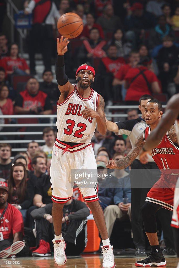 Richard Hamilton #32 of the Chicago Bulls passes the ball against Monta Ellis #11 of the Milwaukee Bucks on January 9, 2013 at the United Center in Chicago, Illinois.