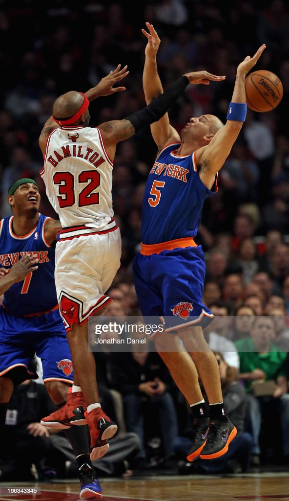 Richard Hamilton #32 of the Chicago Bulls passes the ball between the arms of Jason Kidd #5 of the New York Knicks at the United Center on April 11, 2013 in Chicago, Illinois.