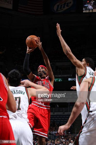 Richard Hamilton of the Chicago Bulls shoots against Ersan Ilyasova and Tobias Harris of the Milwaukee Bucks during the NBA game on November 24 2012...
