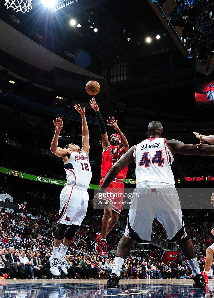 Richard Hamilton #32 of the Chicago Bulls shoots against John Jenkins #12 of the Atlanta Hawks on February 2, 2013 at Philips Arena in Atlanta, Georgia.