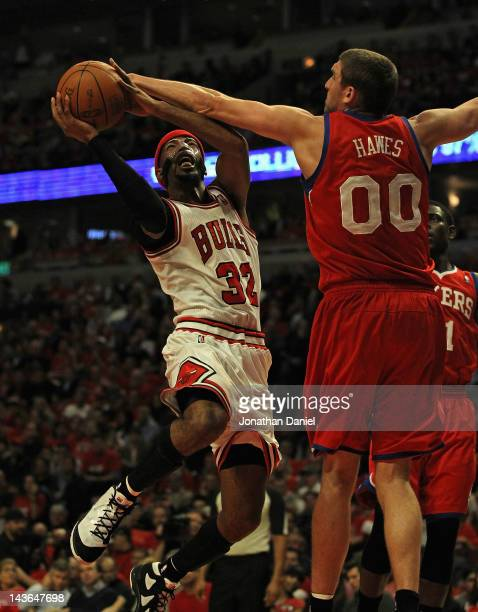 Richard Hamilton of the Chicago Bulls tries to get off a a shot against Spencer Hawes of the Philadelphia 76ers in Game Two of the Eastern Conference...
