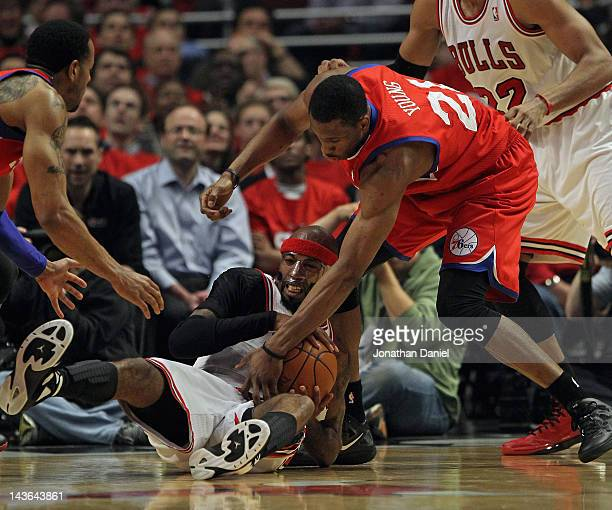 Richard Hamilton of the Chicago Bulls tries to keep the ball away from Thaddeus Young of the Philadelphia 76ers in Game Two of the Eastern Conference...