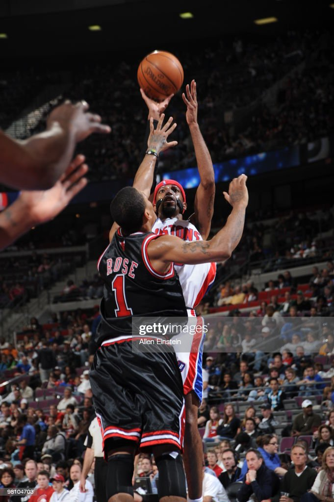 Richard Hamilton of the Detroit Pistons attempts a shot against Derrick Rose of the Chicago Bulls in a game at the Palace of Auburn Hills on March 28...