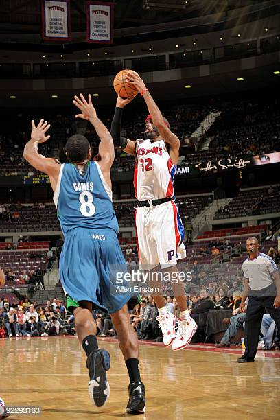 Richard Hamilton of the Detroit Pistons attempts a shot against Ryan Gomes of the Minnesota Timberwolves in a preseason game at the Palace of Auburn...
