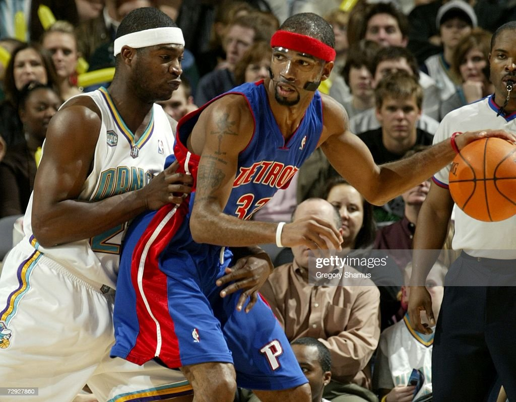 Richard Hamilton #32 of the Detroit Pistons backs in against Devin Brown #23 of the New Orleans/Oklahoma City Hornets on January 4, 2007 at the Ford Center in Oklahoma City, Oklahoma.