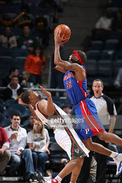 Richard Hamilton of the Detroit Pistons draws a foul against Charlie Bell of the Milwaukee Bucks on February 9 2010 at the Bradley Center in...