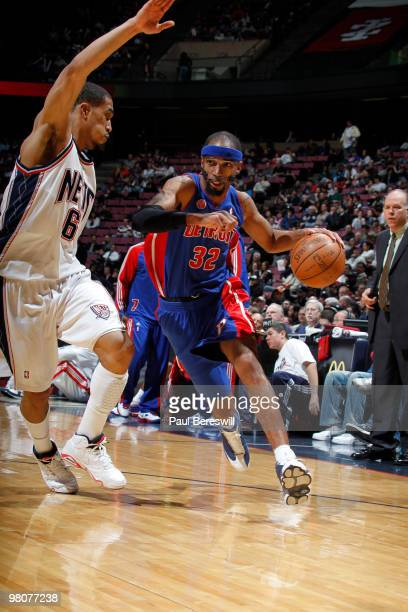 Richard Hamilton of the Detroit Pistons drives against Courtney Lee of the New Jersey Nets during a game on March 26 2010 at Izod Center in East...