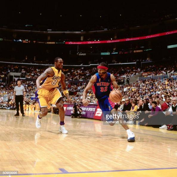 Richard Hamilton of the Detroit Pistons drives to the basket against Kobe Bryant of the Los Angeles Lakers during Game two of the 2004 NBA Finals at...