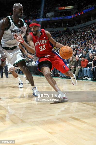 Richard Hamilton of the Detroit Pistons drives to the basket around Kevin Garnett of the Minnesota Timberwolves on January 24 2006 at the Target...