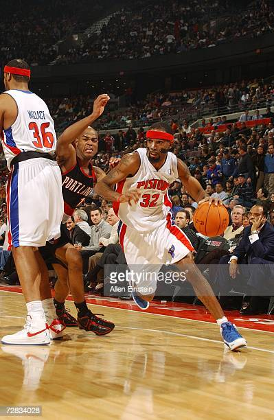 Richard Hamilton of the Detroit Pistons drives to the basket as Rasheed Wallace screens Jarrett Jack of the Portland Trail Blazers on December 5 2006...