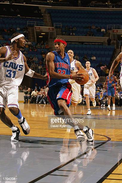 Richard Hamilton of the Detroit Pistons drives to the basket during the NBA game against the Cleveland Cavaliers at Gund Arena on December 18 2002 in...