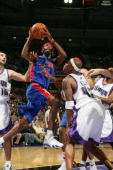 Richard Hamilton of the Detroit Pistons drives to the basket for a layup against Bonzi Wells of the Sacramento Kings on November 8 2005 at the ARCO...