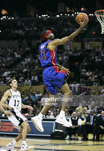 Richard Hamilton of the Detroit Pistons gets an easy basket in front of Brent Barry of the San Antonio Spurs in Game one of the 2005 NBA Finals on...