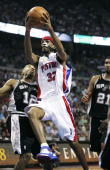 Richard Hamilton of the Detroit Pistons gets to the basket in the first quarter past Bruce Bowen of the San Antonio Spurs in Game four of the 2005...