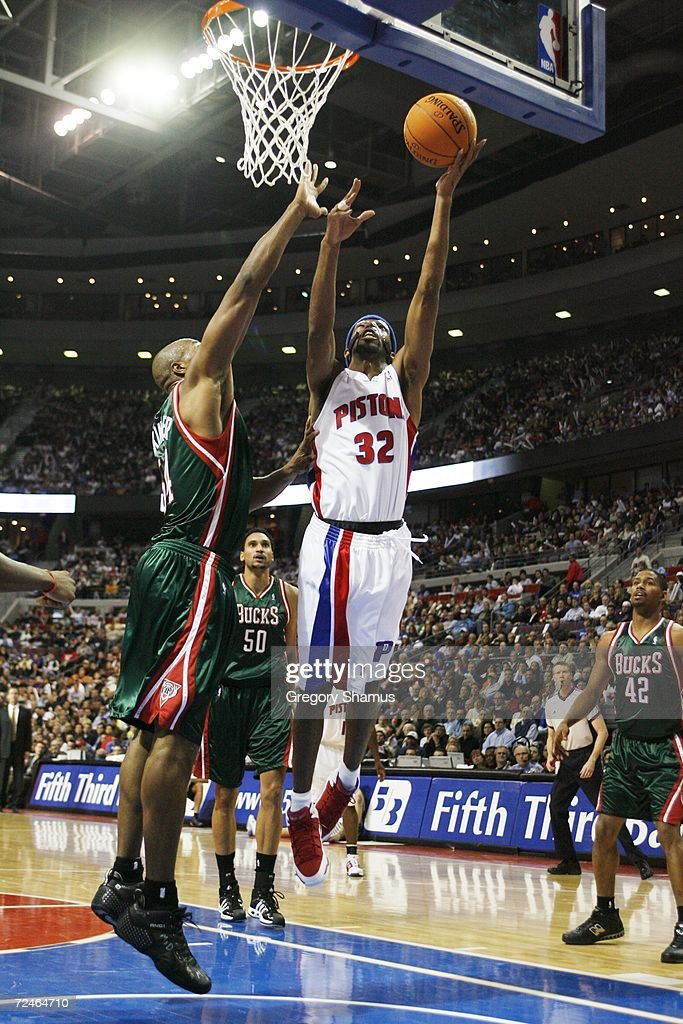 Richard Hamilton #32 of the Detroit Pistons goes to the basket against Brian Skinner #54 of the Milwaukee Bucks on November 1, 2006 at the Palace of Auburn Hills in Auburn Hills, Michigan. Milwaukee won the game 105-97.