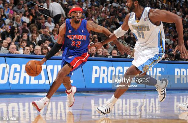 Richard Hamilton of the Detroit Pistons goes to the basket against Nene of the Denver Nuggets on February 26 2010 at the Pepsi Center in Denver...