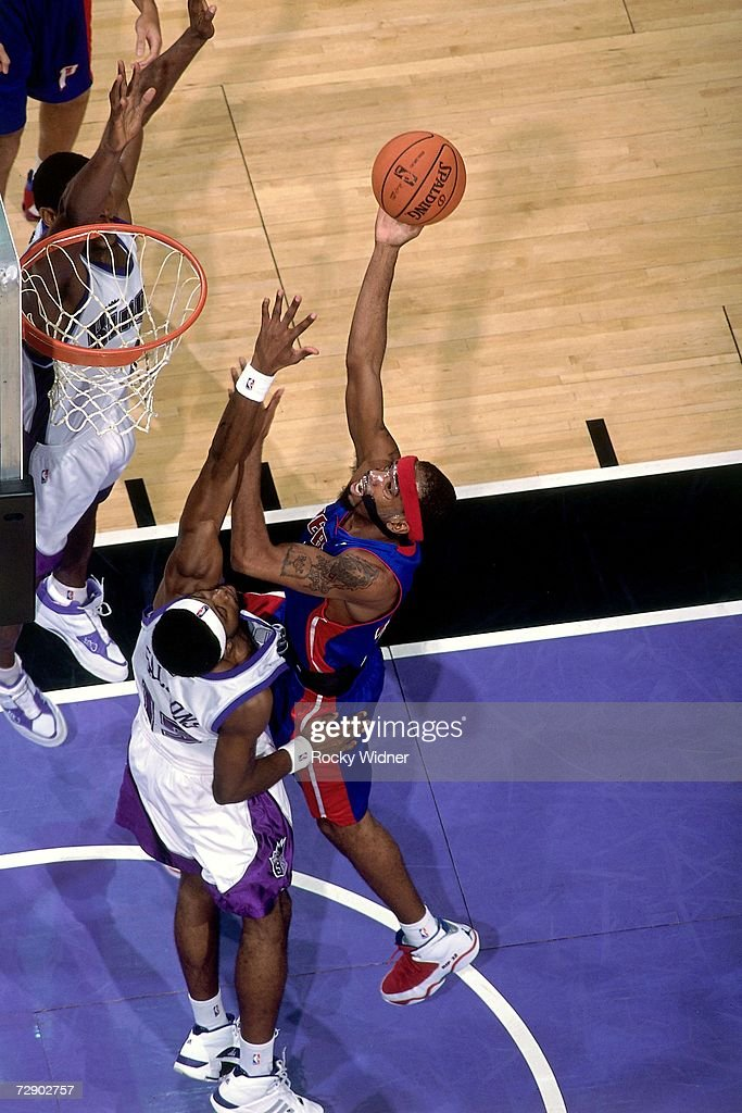 Richard Hamilton #32 of the Detroit Pistons goes up for a shot against John Salmons #15 of the Sacramento Kings during a game at Arco Arena on November 8, 2006 in Sacramento, California. The Kings won 99-86.