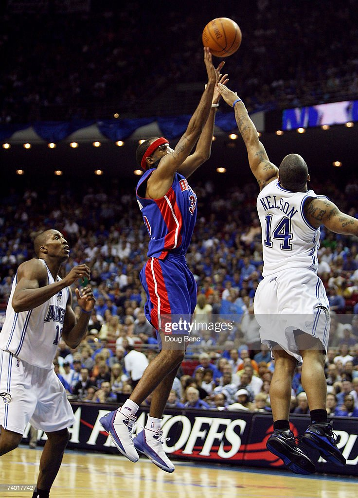 Richard Hamilton #32 of the Detroit Pistons scores over Jameer Nelson #14 and past Dwight Howard #12 of the Orlando Magic late in the game to give the Pistons a lead they never gave back in Game Four of the Eastern Conference Quarterfinals during the 2007 NBA Playoffs at Amway Arena on April 28, 2007 in Orlando, Florida. The Pistons defeated the Magic 97-93 to advance to the next round.