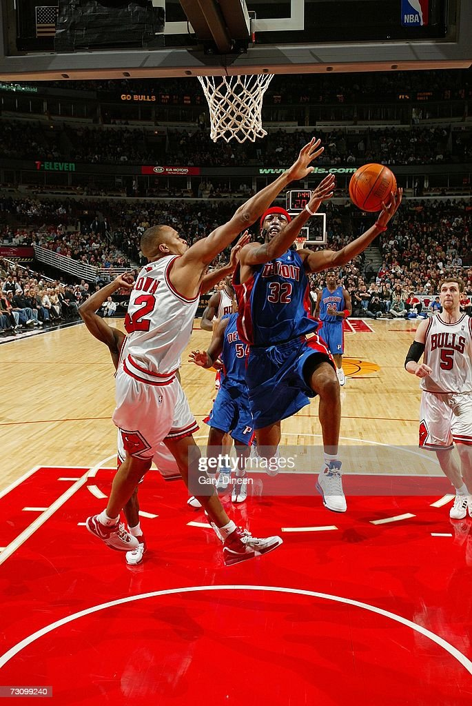 Richard Hamilton #32 of the Detroit Pistons shoots a layup against P.J. Brown #42 of the Chicago Bulls during the game at the United Center on January 6, 2007 in Chicago, Illinois. The Bulls won 106-89.