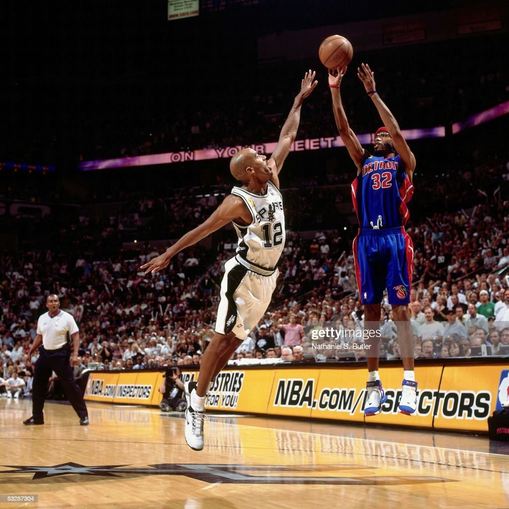 Richard Hamilton #32 of the Detroit Pistons shoots against Bruce Bowen #12 of the San Antonio Spurs in Game Seven of the 2005 NBA Finals June 23, 2005 at the SBC Center in San Antonio, Texas. The Spurs defeated the Pistons 81-74.