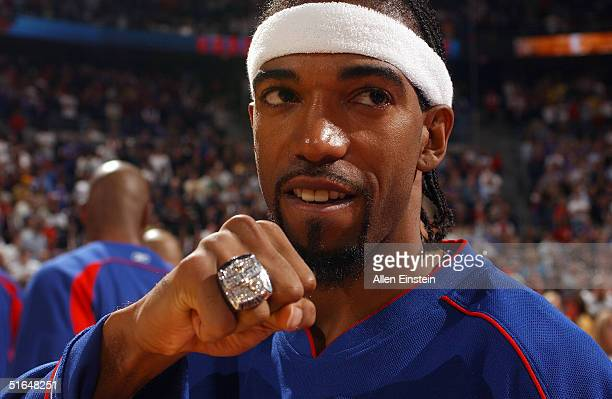 Richard Hamilton of the Detroit Pistons shows off his 2004 NBA Championship ring prior to the game against the Houston Rockets on November 2 2004 at...