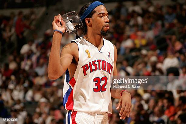 Richard Hamilton of the Detroit Pistons takes off his face mask as he heads to the bench against the San Antonio Spurs in Game Five of the 2005 NBA...