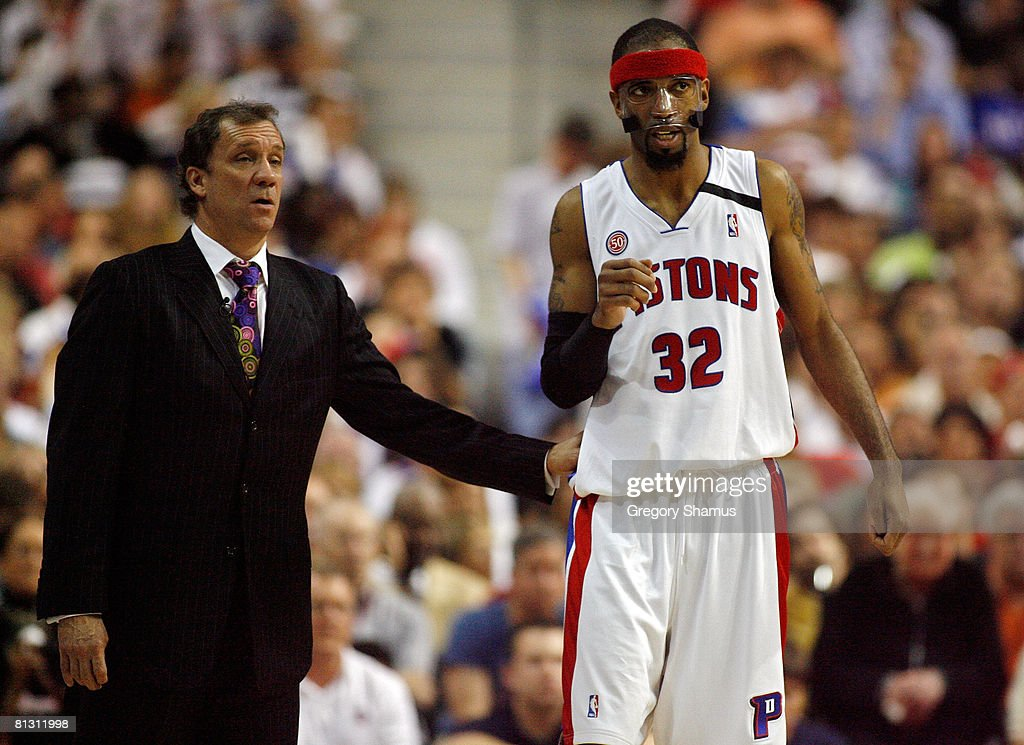 Richard Hamilton talks with head coach Flip Saunders of the Detroit Pistons against the Boston Celtics during Game Six of the Eastern Conference...
