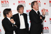 Richard Hammond James May and Jeremy Clarkson pose with their Most Popular Factual Programme Award in front of the winners boards at the National...