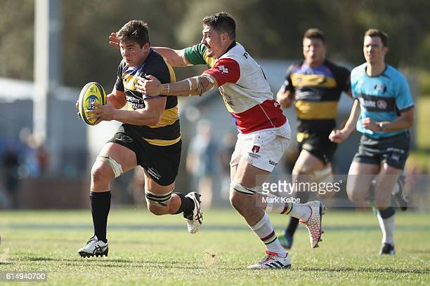Richard Hardwick of the Spirit is tackled during the NRC Semi Final match between the Sydney Rays and Perth Spirit at Pittwater Park on October 16...