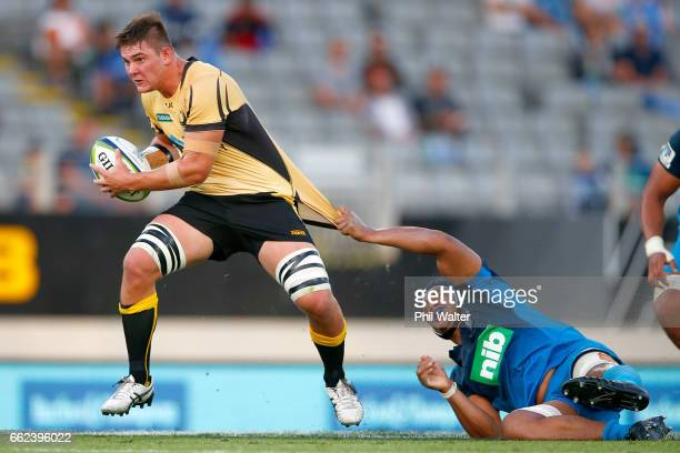 Richard Hardwick of the Western Force is tackled during the round six Super Rugby match between the Blues and the Force at Eden Park on April 1 2017...