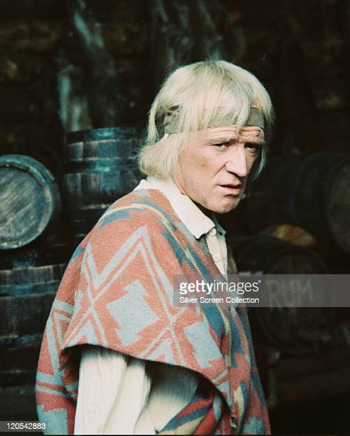 Richard Harris wearing a poncho in a publicity still issued for the film 'A Man Called Horse' 1970 The western directed by Elliot Silverstein starred...