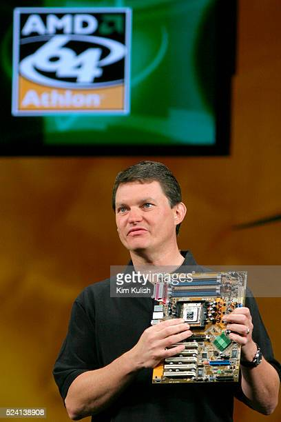 Richard Heye Vice President and General Manager of the Microprocessor Business Unit for Advanced Micro Devices holds a new motherboard during the...