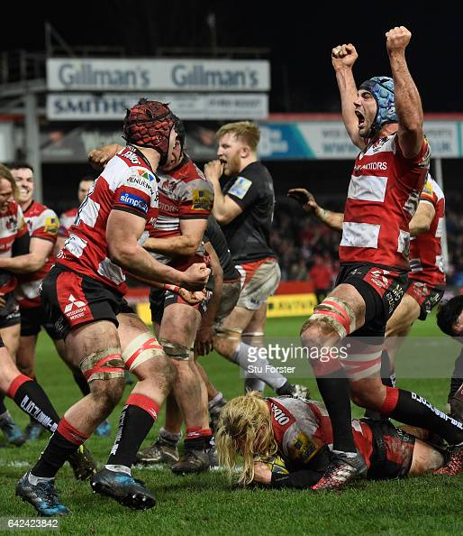Richard Hibbard of Gloucester goes over to score as his Gloucester team mates celebrate during the Aviva Premiership match between Gloucester Rugby...