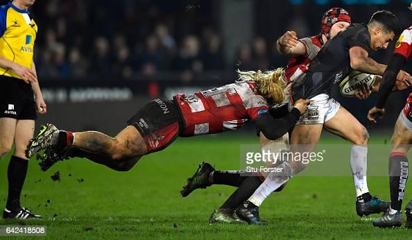 Richard Hibbard of Gloucester hangs onto Saracens flyhalf Alex Lozowski during the Aviva Premiership match between Gloucester Rugby and Saracens at...
