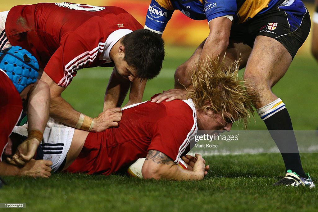 Richard Hibbard of the Lions dives over to score a try during the match between Combined Country and the British & Irish Lions at Hunter Stadium on June 11, 2013 in Newcastle, Australia.