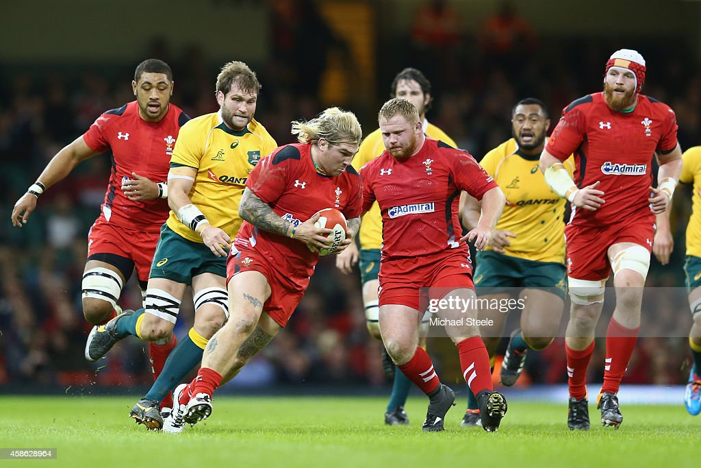 Richard Hibbard of Wales is chased by Ben McCalman of Australia during the International match between Wales and Australia at the Millennium Stadium...
