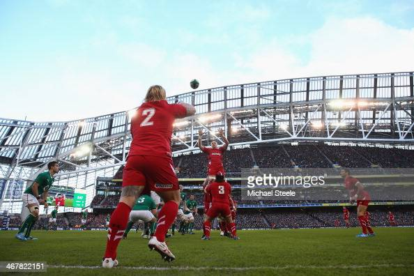 Richard Hibbard of Wales throws to Andrew Coombs in the lineout during the RBS Six Nations match between Ireland and Wales at the Aviva Stadium on...