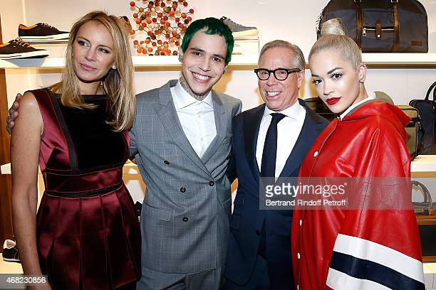 Richard Hilfiger Singer Rita Ora and his Parents Tommy Hilfiger and Dee Hilfiger attend the Tommy Hilfiger Boutique Opening at Boulevard Capucines on...