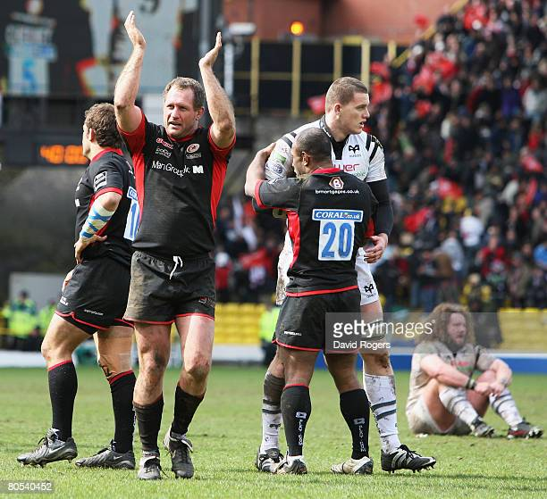 Richard Hill of Saracens the Man of the match applauds the fans following his team's 1910 victory during the Heineken Cup Quarter Final match between...