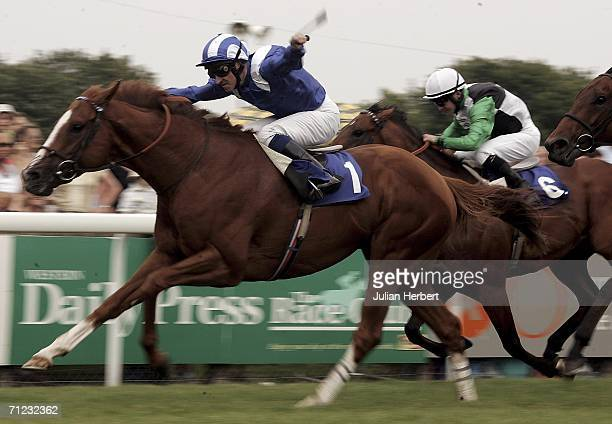 Richard Hills and Etlaala land The Axminster Carpets Cathedral Stakes Race run at Salisbury Racecourse on June 18 in Salisbury England