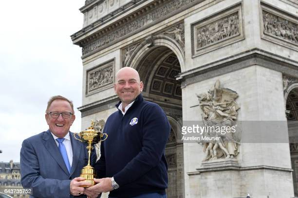 Richard Hills and Thomas Bjorn Captain for the 2018 Ryder Cup in France poses with the Ryder Cup Trophy in front of the Arc De Triomphe on February...