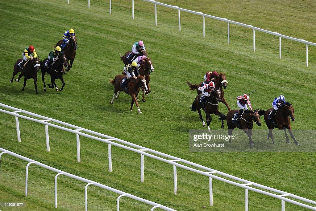 Richard Hills riding Ektihaam (R) wins The Highclere Thoroughbred Racing EBF Maiden Stakes at Newbury racecourse on July 15, 2011 in Newbury, England