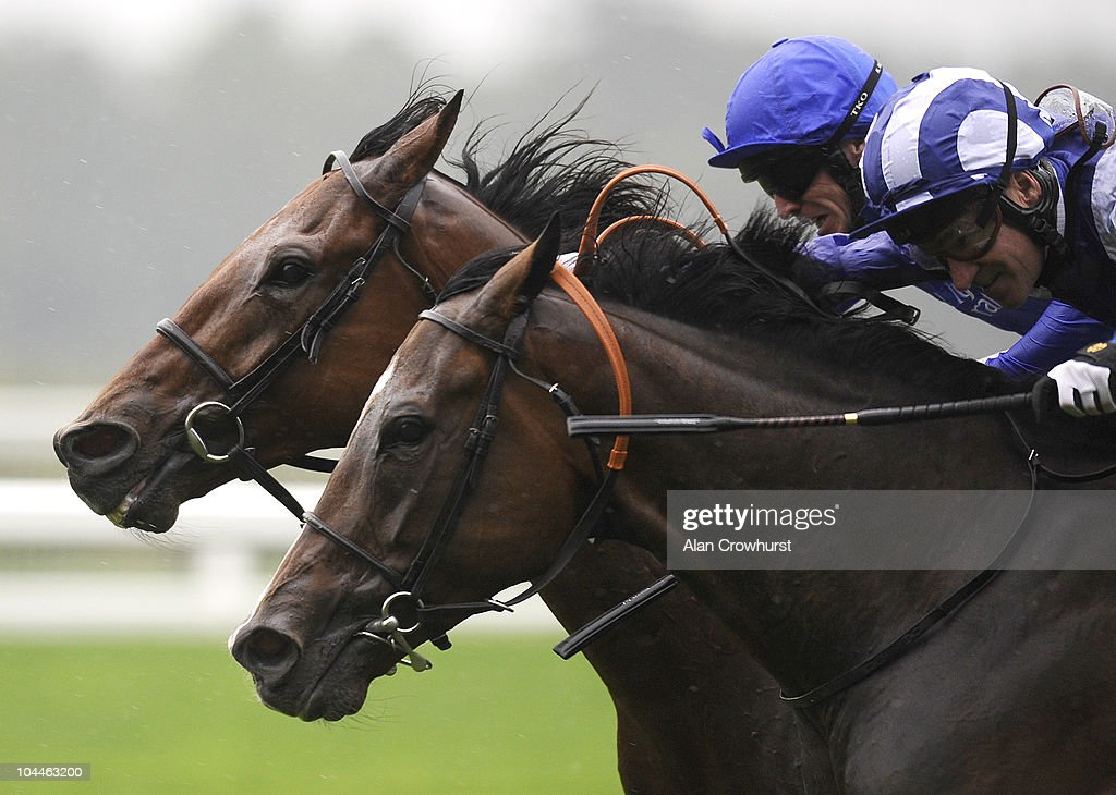 Richard Hills riding Laaheb (R) battles with Whispering Gallery and Kieren Fallon before winning The Grosvenor Casinos Cumberland Lodge Stakes at Ascot racecourse on September 26, 2010 in Ascot, England