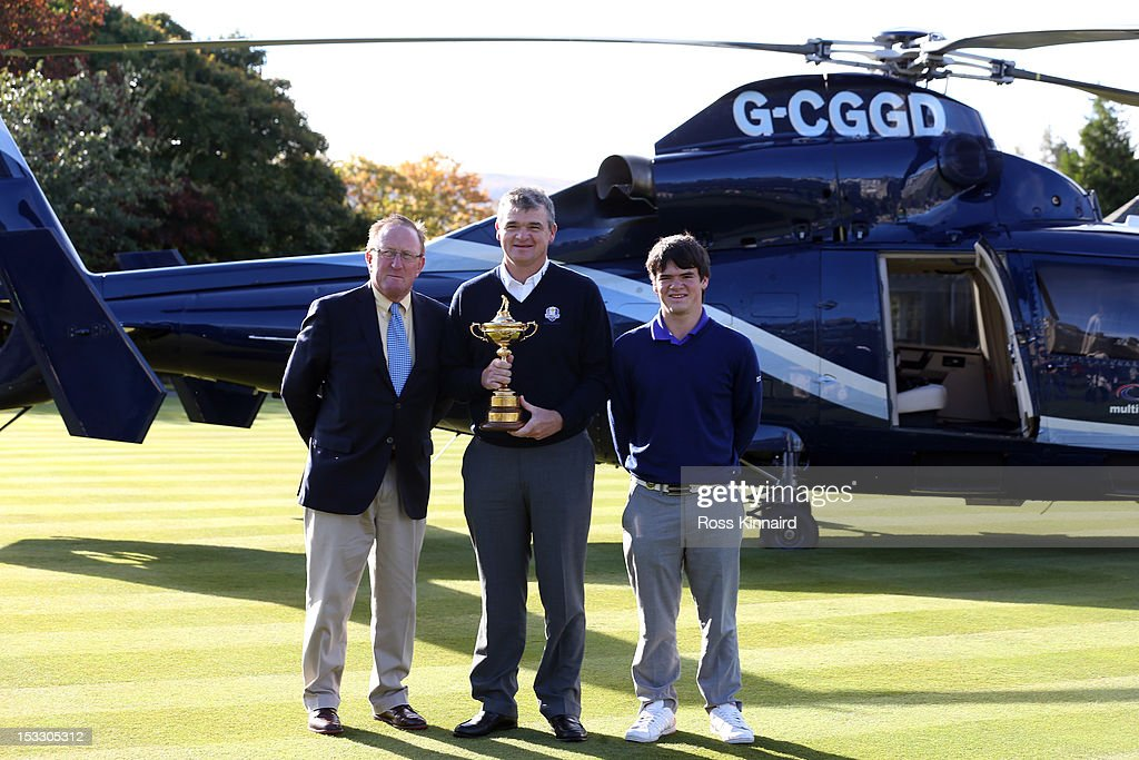 <a gi-track='captionPersonalityLinkClicked' href=/galleries/search?phrase=Richard+Hills+-+Golf+Administrator&family=editorial&specificpeople=15289955 ng-click='$event.stopPropagation()'>Richard Hills</a>, Ryder Cup Director, <a gi-track='captionPersonalityLinkClicked' href=/galleries/search?phrase=Paul+Lawrie&family=editorial&specificpeople=202995 ng-click='$event.stopPropagation()'>Paul Lawrie</a> of Scotland and his son Craig Lawrie fly in to the grounds of the Gleneagles Hotel during the offical handover of the Ryder Cup to The Gleneagles Hotel, the hosts of the 2014 event, at Gleneagles on October 3, 2012 in Auchterarder, Scotland.