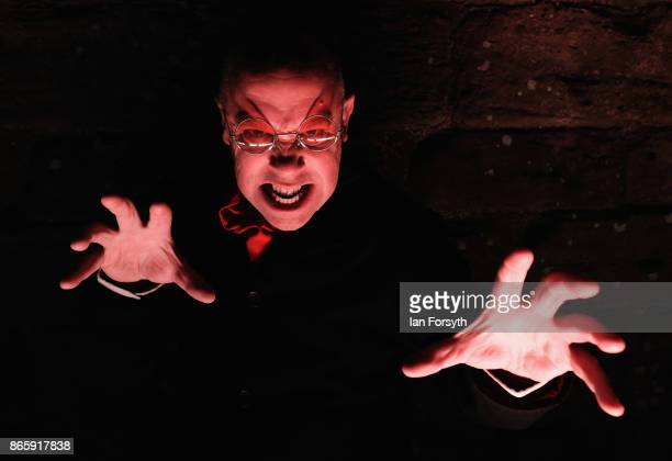 Richard Hollick plays Dracula during a spectacular light display illuminating the ruins of the historic Whitby Abbey on October 24 2017 in Whitby...