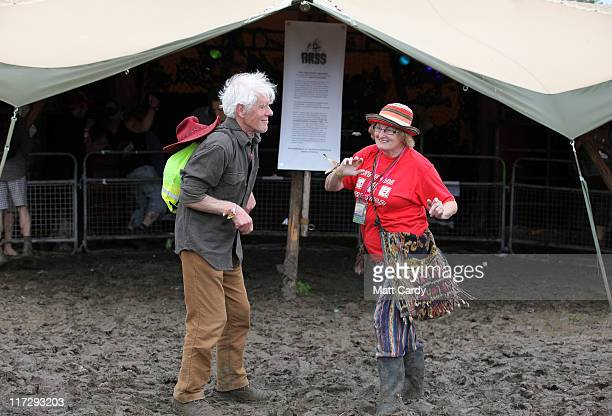 Richard Hopkinson and Meryl Knapp who are both 70 and from Yorkshire dance outside a reggae music tent as they visit a festival for the first time in...