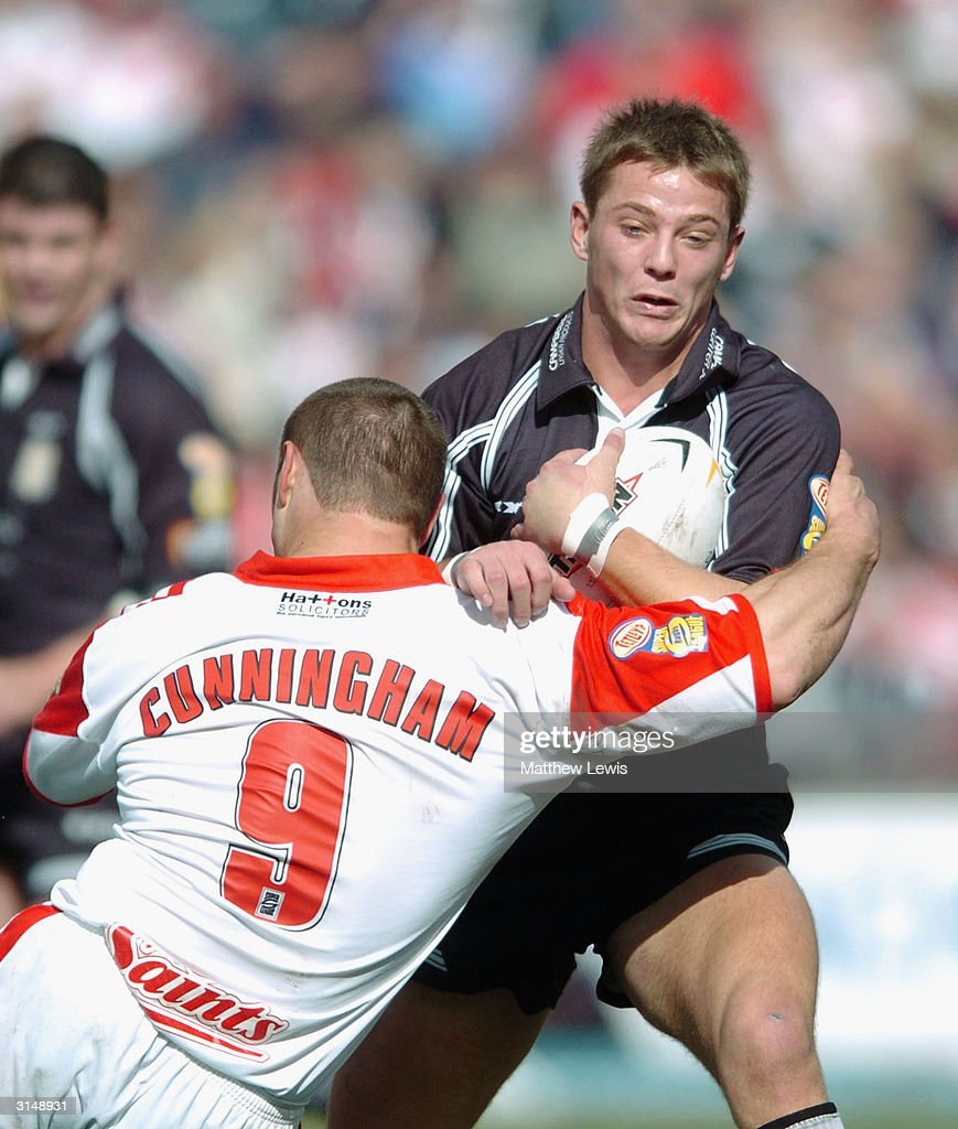 Richard Horne of Hull is tackled by Kieron Cunningham of StHelens during the Powergen Challenge Cup Quarter Final match between St Helens and Hull FC...