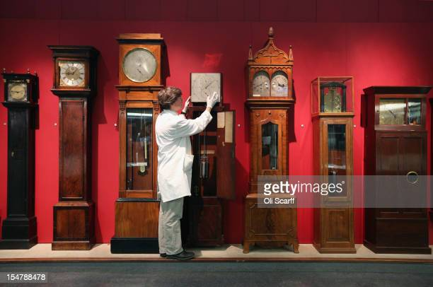Richard Horton a Conservator at the Science Museum adjusts a Regulator clock by Cope Molyneux dating from 1822 to begin putting clocks back for the...