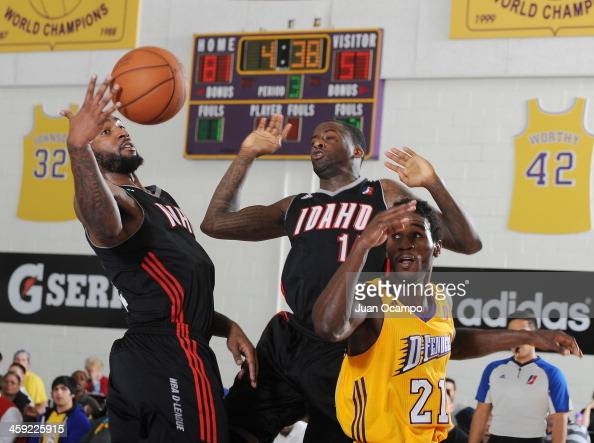 Richard Howell and Christian Kabongo of the Idaho Stampede battle for the loose ball against Kareem Rush of the Los Angeles DFenders on December 21...
