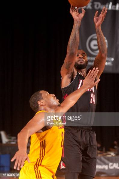 Richard Howell of the Idaho Stampede shoots over defender Kevin Jones of the Canton Charge during the 2014 NBA DLeague Showcase on January 6 2014 at...